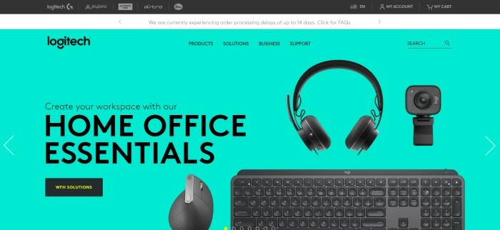 This screenshot of the home page for Logitech has a black and white header above an aqua-colored main section with black text inviting people to create their home office workspace with Logitech products, along with overlaying images of a Logitech headset, keyboard, camera, and mouse.