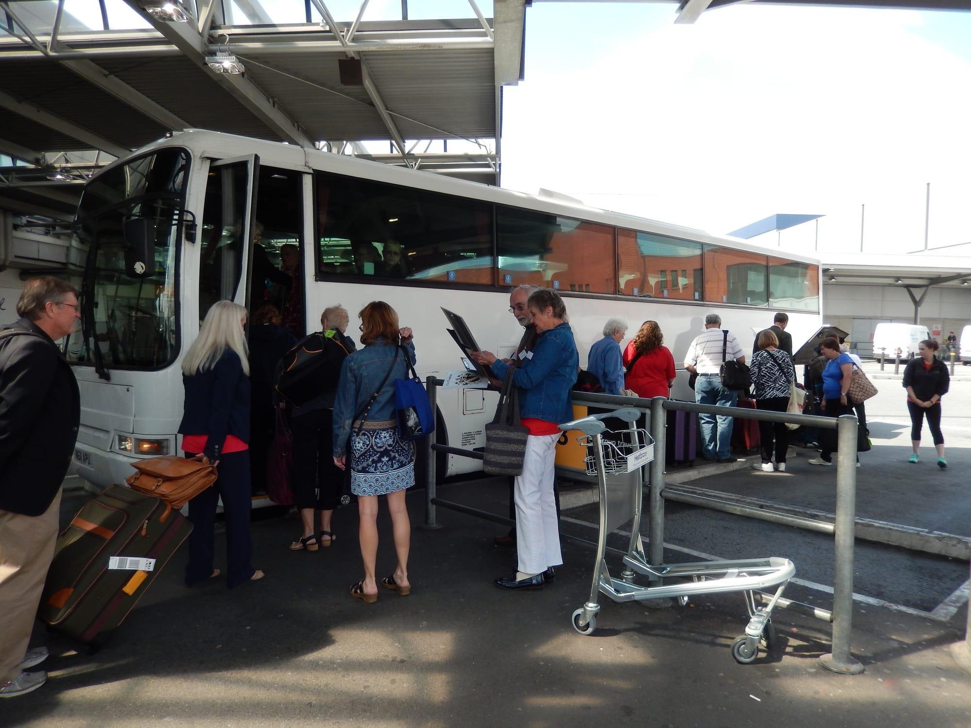 CFA members boarding buses at Heathrow Airport in 2014