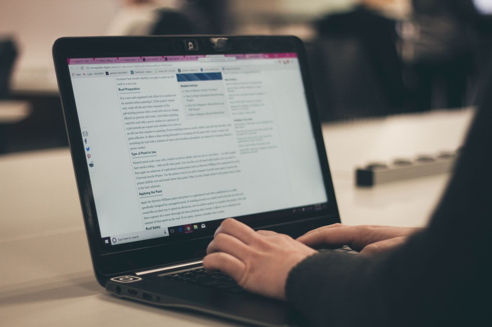 Written Content For SEO Being Reviewed On Laptop