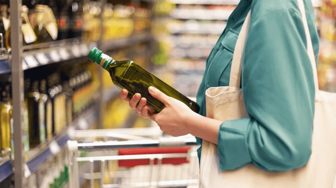 A woman shopping for olive oil