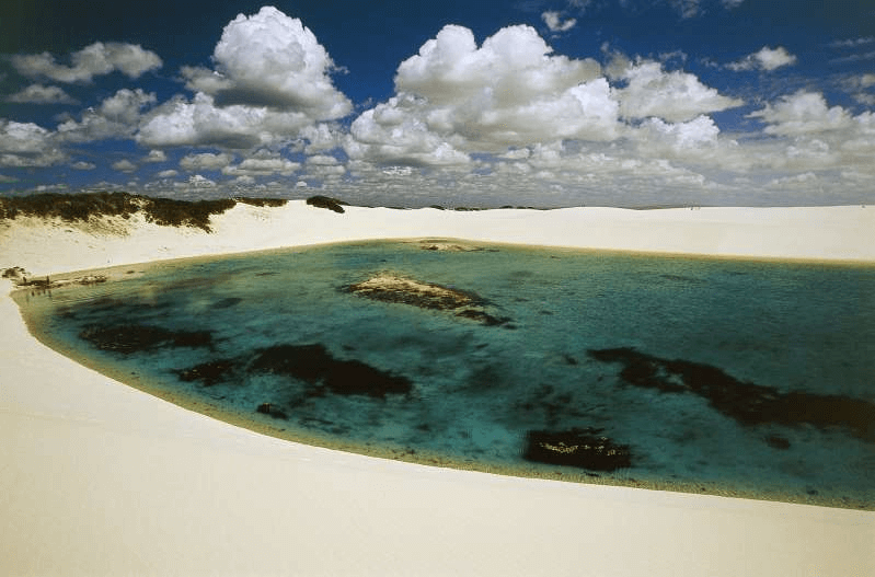 BRAZIL - OCTOBER 27: The sand dunes known as white sheets (lencois) and freshwater lakes of changing colours, formed by precipitation, Lencois Maranhenses National Park, State of Maranhao, Brazil. (Photo by DeAgostini/Getty Images)