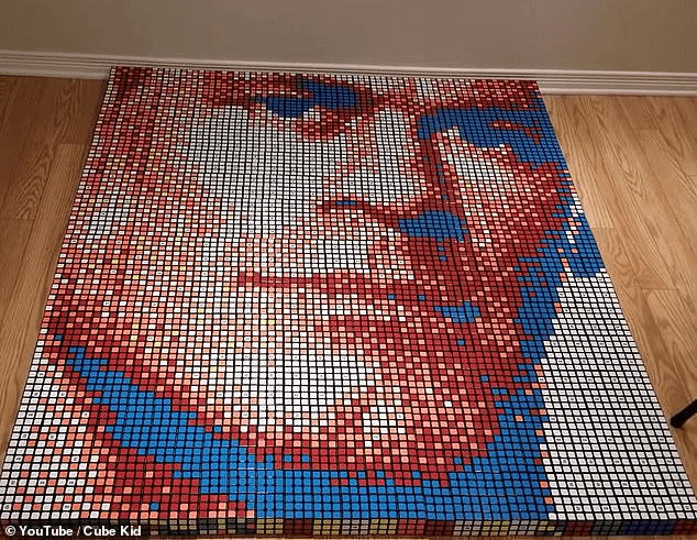 Amazing: The entire portrait was made out of Rubik's cubes. Benjamin's mom said his dyslexia helped him have the incredible talent