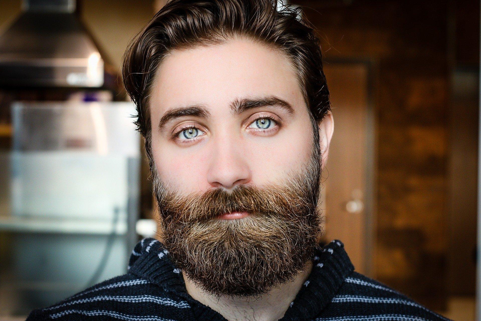 A beard, designer stubble, a mustache, or a clean-shaven face?