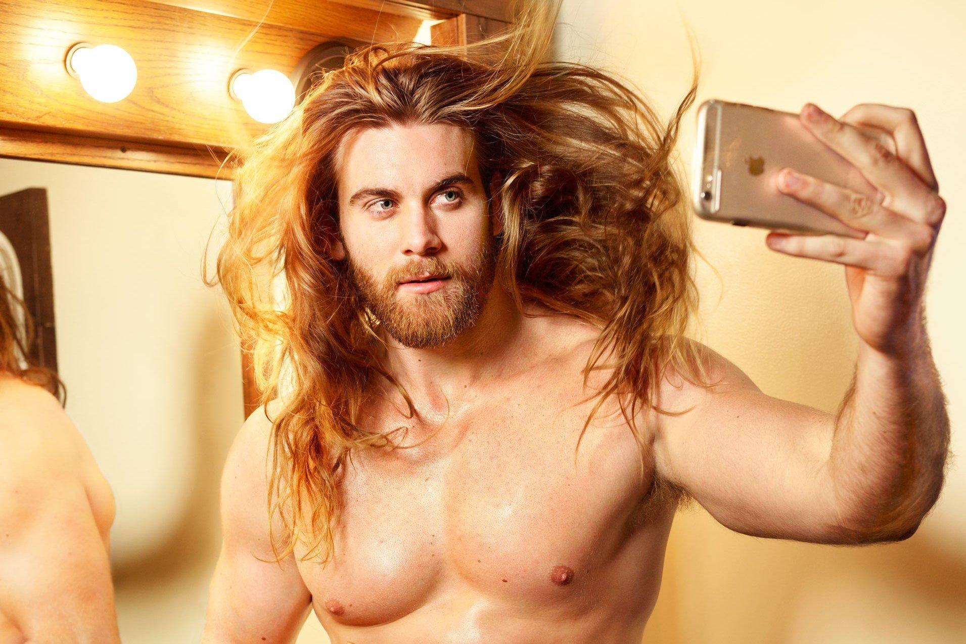 long hair and a beard in men