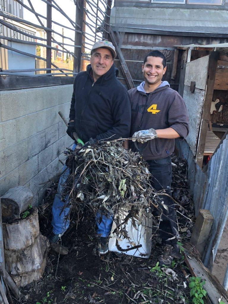 Volunteers Mark Haprov, left, and Wilfredo Rodezno.
