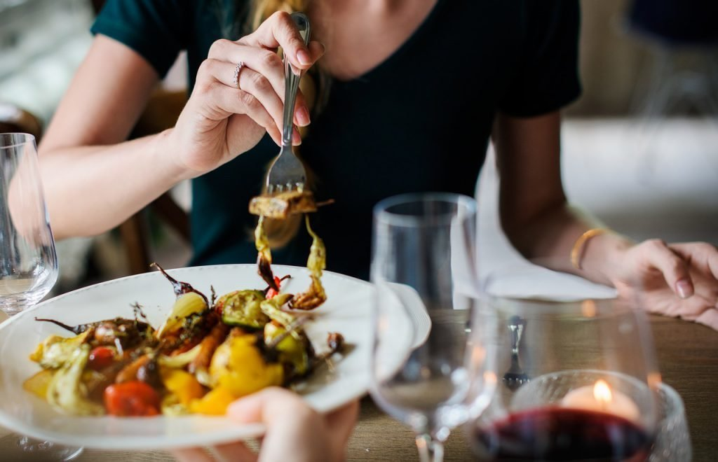 Woman eating stuffed peppers