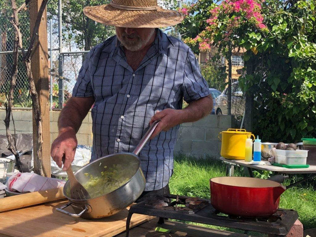Joe Corso preparing braised leeks.